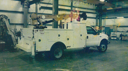 white IMT dominator 1 circa 1990 with yellow 3016 telesopic crane and workbench bumper.