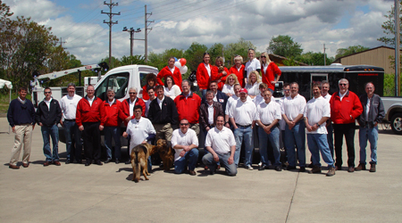 QT Equipment Team in red in front of a Ford Sprinter for Lot Fair.