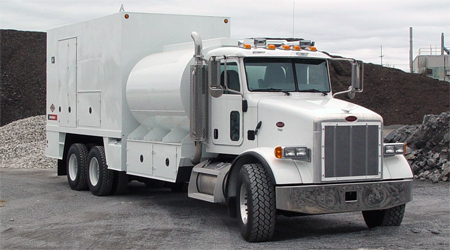 enclosed lube truck with fuel on Peterbilt chassis tandem axle.  IMT equipment, eliptical diesel fuel tank.